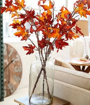 tall glass vase with fall leaf branches