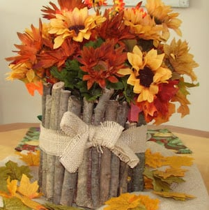 Rustic Stick Vase filled with fall florals