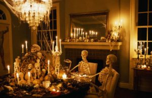 ca. 1995, Shreveport, Louisiana, USA --- Skeletons sits at a dining room table during a Halloween party at the home of William Joyce, well-known children's writer and illustrator. --- Image by © Philip Gould/CORBIS