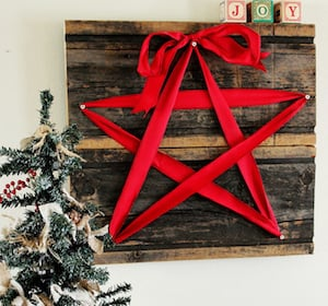 christmas star wide red ribbon nails pallet wood hammer