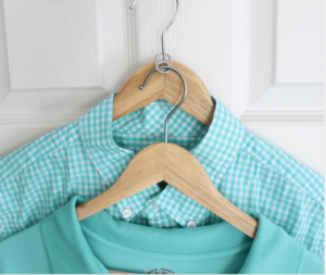 stacking shirts with Soda Tabs on a coat hanger