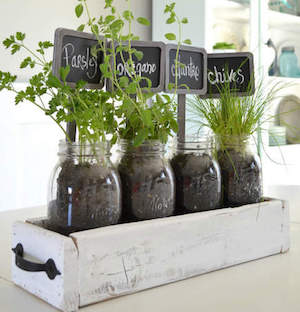 Table Top Herb Garden From A Pallet Scrap Wood + Chalk Paint + Two Handles  + Mason Jars + Nails And Hammer