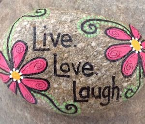 live love laugh rock with flowers on the side