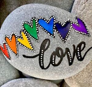love word rock with rainbow hearts