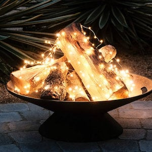 Faux Fire Pit with string lights and wood