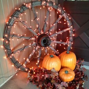 if you happen to have an extra wagon wheel lying around then this would be a cheap idea that would give your fall decor a rustic touch - Fall Decor