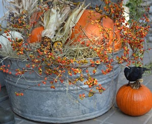 galvanized tub filled with fall decorations for the porch