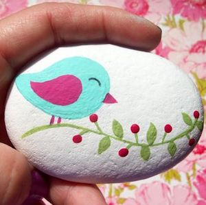 Bird on branch painted stone