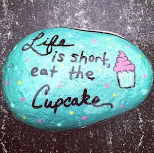 rock painted with Life is short, eat the cupcake