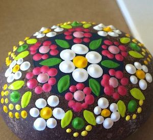 rock painted with colorful flowers