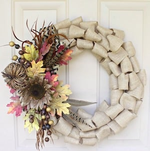burlap wreath with fall florals on the side