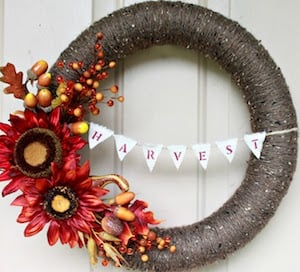 Yarn Fall Wreathwith harvest banner and fall florals