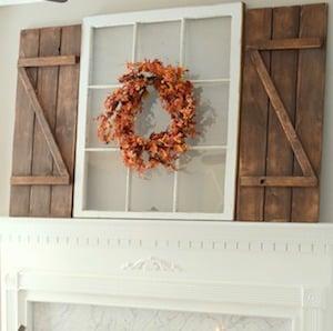 diy barn shutters and fall wreath above mantel
