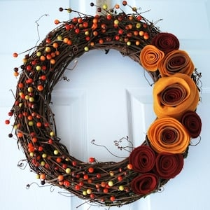 grapevine Wreath with fall berries and Felt Rosettes