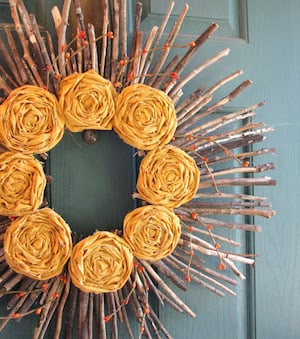autumn stick wreath with fabric flowers