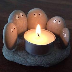 Rocks Huddled Around a tea light candle