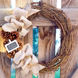 Rustic DIY Fall Wreath with pinecones and burlap ribbon