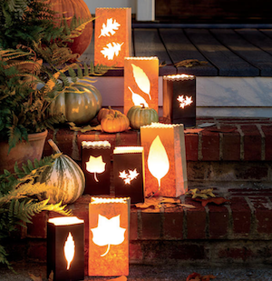 Paper Luminaries with fall leaves lining porch stairs