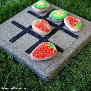 Fruit rocks on a tic tac toe board