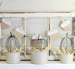 Farmhouse Natural Mantel with chicken wire pumpkins and window frame