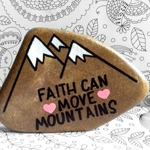 Faith Can Move Mountains word rock with mountains in the background