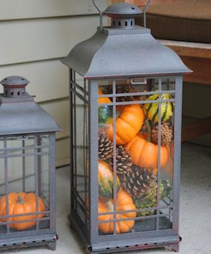 Fall Lantern filled with pinecones, pumpkins and gourds