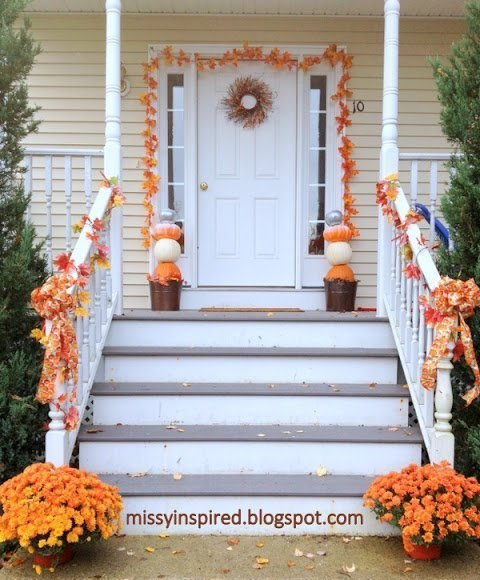 simple fall garland for door and stairs with mums and a pumpkin topiary