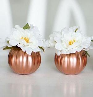 copper pumpkins with magnolia flowers