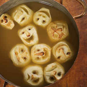 Shrunken Heads in apple Cider halloween drink for a party