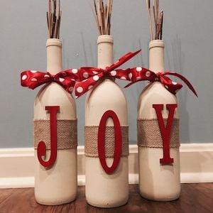 Wood Letters + Red Acrylic Paint + Burlap Ribbon + Wine Bottles + White Spray Paint + Christmas Ribbon