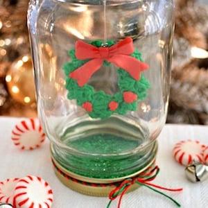 mason jar christmas snow globe mason jar red and green twine mod podge glitter christmas ornament