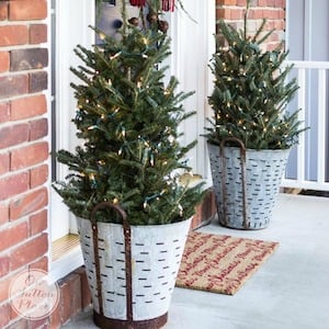 festive and frugal christmas porch galvanized olive baskets small trees clear lights - Farmhouse Christmas Decor