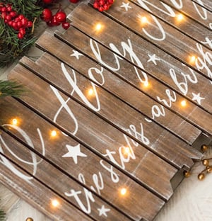 light up christmas sign wooden light up sign painters tape wood stain acrylic paint printed letters you could either buy the sign on sale or make - Pallet Christmas Decoration Ideas