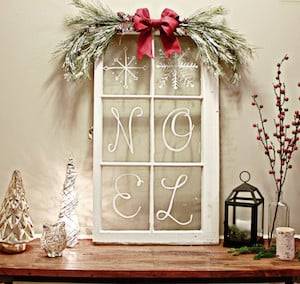 farmhouse window pane christmas decoration window pane white paint pen red ribbon pine clippings snow spray