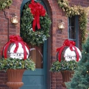 2 large silver balls source unknown 2 plastic balls silver spray paint red ribbon and bows christmas present topiary