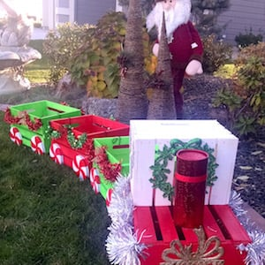 from yard decor to lawn ornaments there are over a hundred diy outdoor christmas decor ideas to choose from christmas crate train