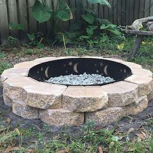 old charcoal grill bowl + retaining wall blocks