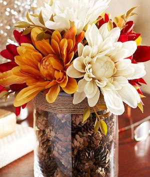 mini pinecones in a twine wrapped vase with mums