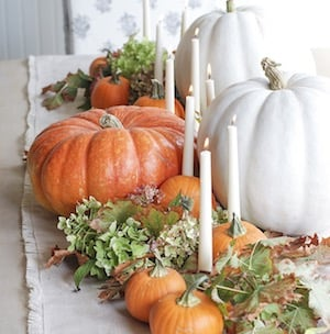 DIY Table Fall Centerpiece with pumpkins, taper candles and greenery