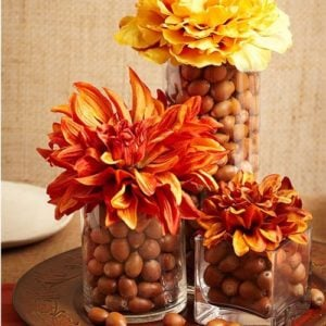 acorns in a vase with mums diy fall centerpiece