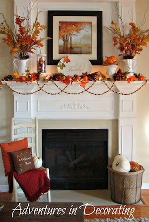 Traditional Fall Mantel with fall leaves in a vase and fall leaf garland