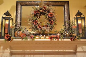 Warm Glow Mantel with fall florals and lanterns
