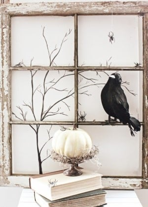 farmhouse Halloween Vignette with crow, old window frame and white pumpkin