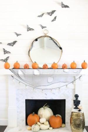 Modern Farmhouse Halloween Mantel with faux bats and mini pumpkins