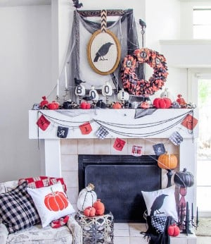 Halloween Mantel with framed crow, garland and wreath