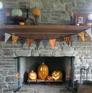 Halloween Mantel with pumpkins in fireplace