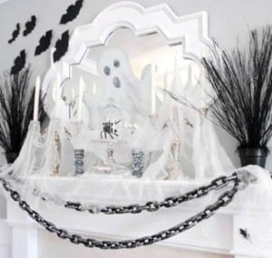 black and white Haunted Mantel with ghosts and chains