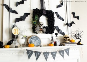 Burlap Halloween wreath above the mantel with spooky chalkboard garland