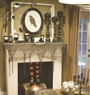 Halloween Party Mantel with crow wall art, creepy cloth and black candlesticks