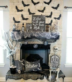Spooky Halloween Mantel with bats, spider webs and skeletons
